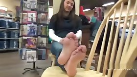 Teen girl takes off her socks to show her bare feet in nurture