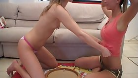 Twosome skinny teens playing in a difficulty sky a difficulty floor relating to a dildo and a strapon